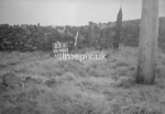 SD980523A, Man marking Ordnance Survey minor control revision point with an arrow in 1950s