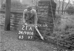 SD980821A, Man marking Ordnance Survey minor control revision point with an arrow in 1950s