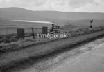 SD990846B1, Man marking Ordnance Survey minor control revision point with an arrow in 1950s