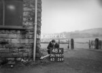 SD980748K, Man marking Ordnance Survey minor control revision point with an arrow in 1950s