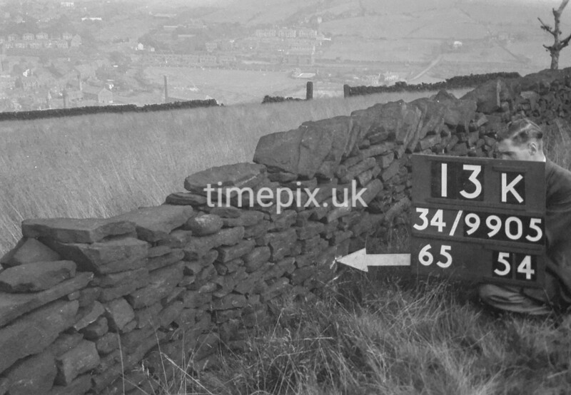 SD990513K, Man marking Ordnance Survey minor control revision point with an arrow in 1950s