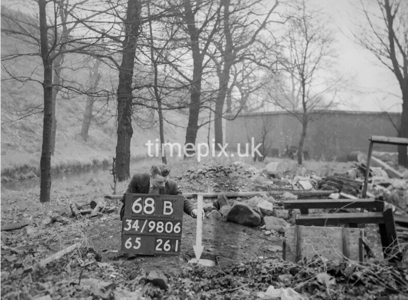 SD980668B, Man marking Ordnance Survey minor control revision point with an arrow in 1950s
