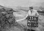 SD990735B, Man marking Ordnance Survey minor control revision point with an arrow in 1950s