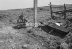 SD980573A2, Man marking Ordnance Survey minor control revision point with an arrow in 1950s