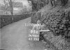 SD980795K, Man marking Ordnance Survey minor control revision point with an arrow in 1950s