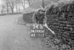 SD990654B, Man marking Ordnance Survey minor control revision point with an arrow in 1950s