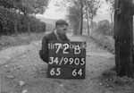 SD990572B, Man marking Ordnance Survey minor control revision point with an arrow in 1950s