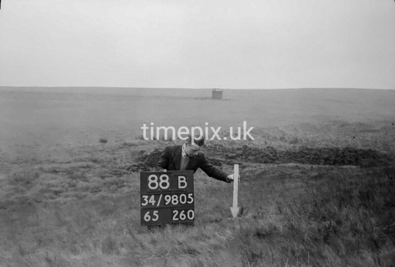 SD980588B, Man marking Ordnance Survey minor control revision point with an arrow in 1950s