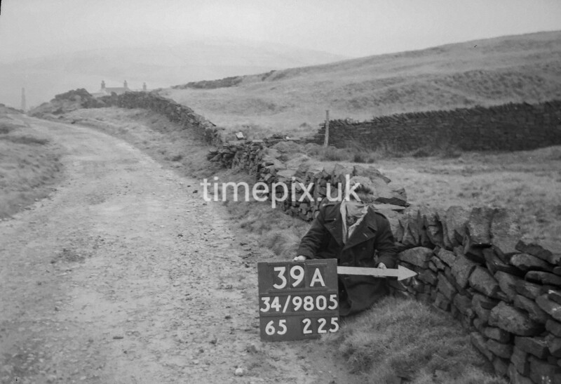 SD980539A, Man marking Ordnance Survey minor control revision point with an arrow in 1950s