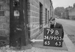 SD990579B, Man marking Ordnance Survey minor control revision point with an arrow in 1950s