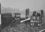 SD990718B, Man marking Ordnance Survey minor control revision point with an arrow in 1950s