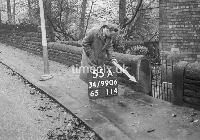 SD990655A1, Man marking Ordnance Survey minor control revision point with an arrow in 1950s