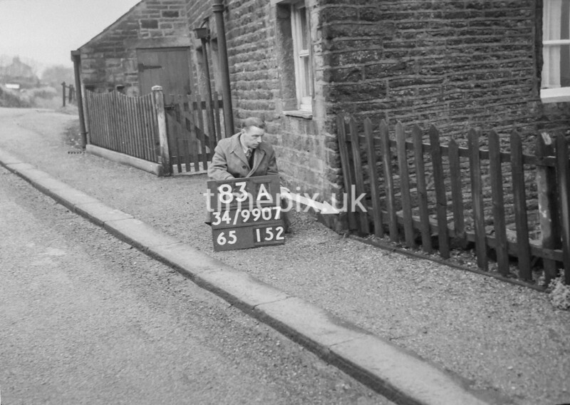 SD990783A1, Man marking Ordnance Survey minor control revision point with an arrow in 1950s