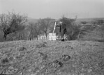 SD950301K, Man marking Ordnance Survey minor control revision point with an arrow in 1950s