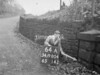SD980464A, Man marking Ordnance Survey minor control revision point with an arrow in 1950s
