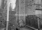 SD980416A, Man marking Ordnance Survey minor control revision point with an arrow in 1950s