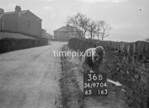 SD970436B, Man marking Ordnance Survey minor control revision point with an arrow in 1950s