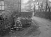 SD980416B, Man marking Ordnance Survey minor control revision point with an arrow in 1950s