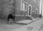 SD970433K, Man marking Ordnance Survey minor control revision point with an arrow in 1950s