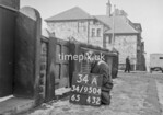 SD950434A, Man marking Ordnance Survey minor control revision point with an arrow in 1950s