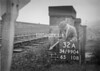 SD990432A, Man marking Ordnance Survey minor control revision point with an arrow in 1950s
