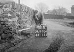 SD970448B, Man marking Ordnance Survey minor control revision point with an arrow in 1950s