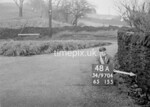 SD970448A, Man marking Ordnance Survey minor control revision point with an arrow in 1950s