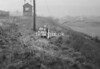 SD980389B, Man marking Ordnance Survey minor control revision point with an arrow in 1950s