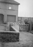 SD970467K, Man marking Ordnance Survey minor control revision point with an arrow in 1950s