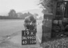 SD990319K, Man marking Ordnance Survey minor control revision point with an arrow in 1950s
