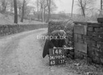 SD980414R, Man marking Ordnance Survey minor control revision point with an arrow in 1950s