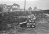 SD990334B, Man marking Ordnance Survey minor control revision point with an arrow in 1950s