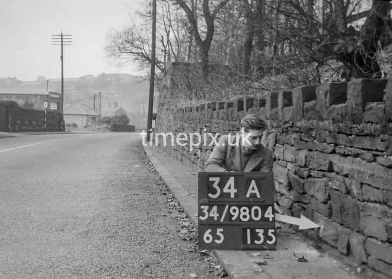SD980434A, Man marking Ordnance Survey minor control revision point with an arrow in 1950s