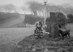 SD970429B, Man marking Ordnance Survey minor control revision point with an arrow in 1950s