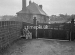 SD980417B, Man marking Ordnance Survey minor control revision point with an arrow in 1950s