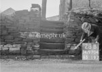 SD970428B, Man marking Ordnance Survey minor control revision point with an arrow in 1950s