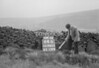SD980364B, Man marking Ordnance Survey minor control revision point with an arrow in 1950s