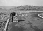 SD950303A, Man marking Ordnance Survey minor control revision point with an arrow in 1950s