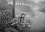 SD970429A, Man marking Ordnance Survey minor control revision point with an arrow in 1950s
