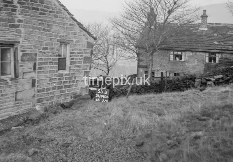 SD980355B, Man marking Ordnance Survey minor control revision point with an arrow in 1950s