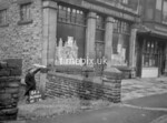 SD980484A, Man marking Ordnance Survey minor control revision point with an arrow in 1950s