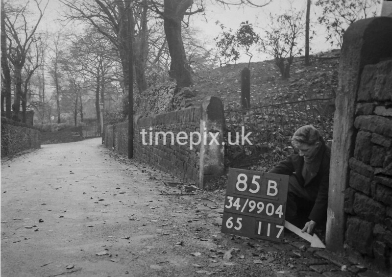 SD990485B, Man marking Ordnance Survey minor control revision point with an arrow in 1950s