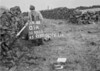 SD990301A, Man marking Ordnance Survey minor control revision point with an arrow in 1950s