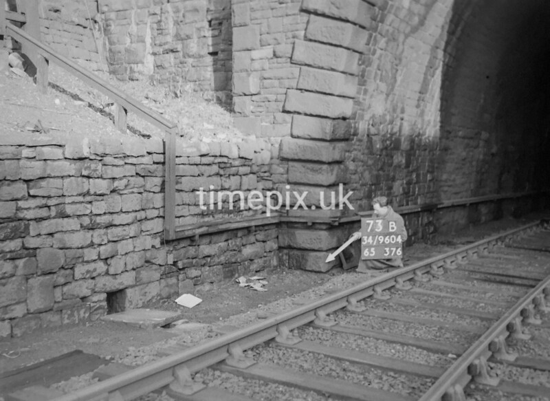 SD960473B, Man marking Ordnance Survey minor control revision point with an arrow in 1950s