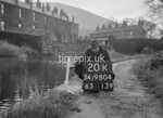 SD980420K, Man marking Ordnance Survey minor control revision point with an arrow in 1950s