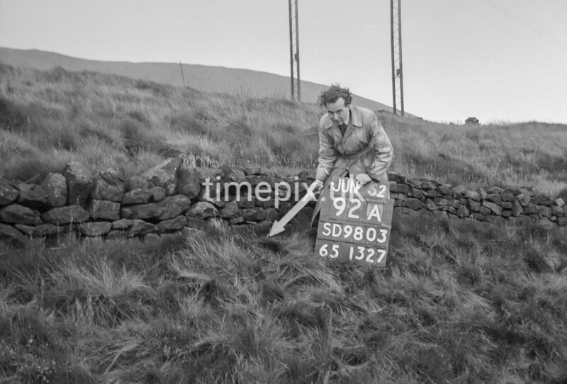 SD980392A, Man marking Ordnance Survey minor control revision point with an arrow in 1950s