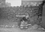 SD970431A, Man marking Ordnance Survey minor control revision point with an arrow in 1950s