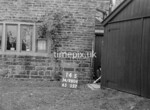 SD980414S, Man marking Ordnance Survey minor control revision point with an arrow in 1950s