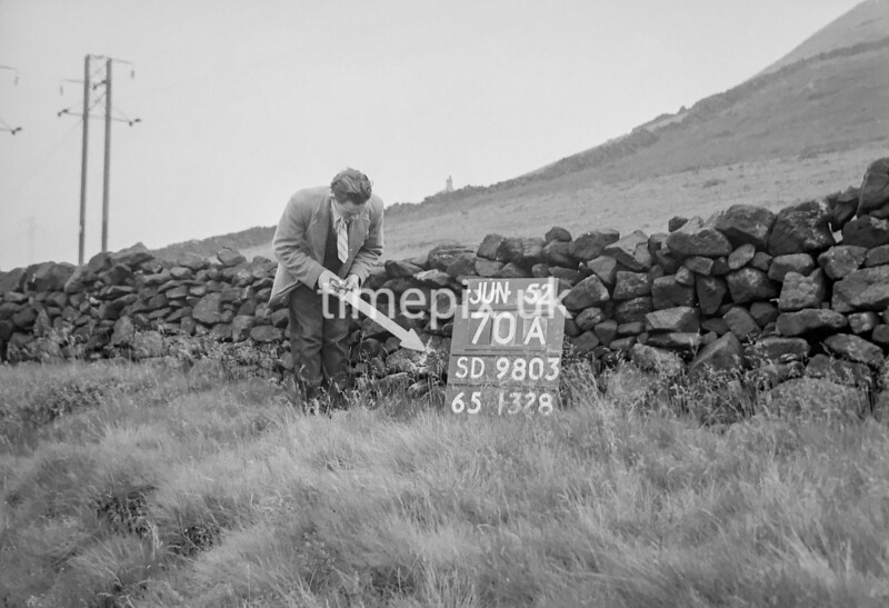 SD980370A, Man marking Ordnance Survey minor control revision point with an arrow in 1950s