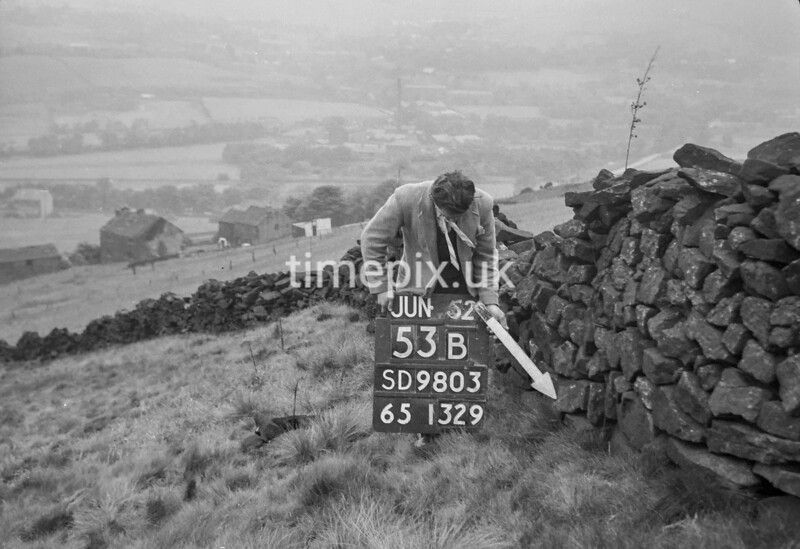 SD980353B, Man marking Ordnance Survey minor control revision point with an arrow in 1950s